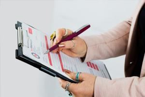 Reds removals staff holding up removal form during costing a house removal